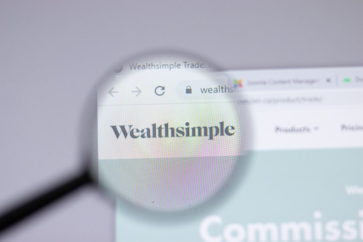 wealth simple investing app on a computer screen under a microscope