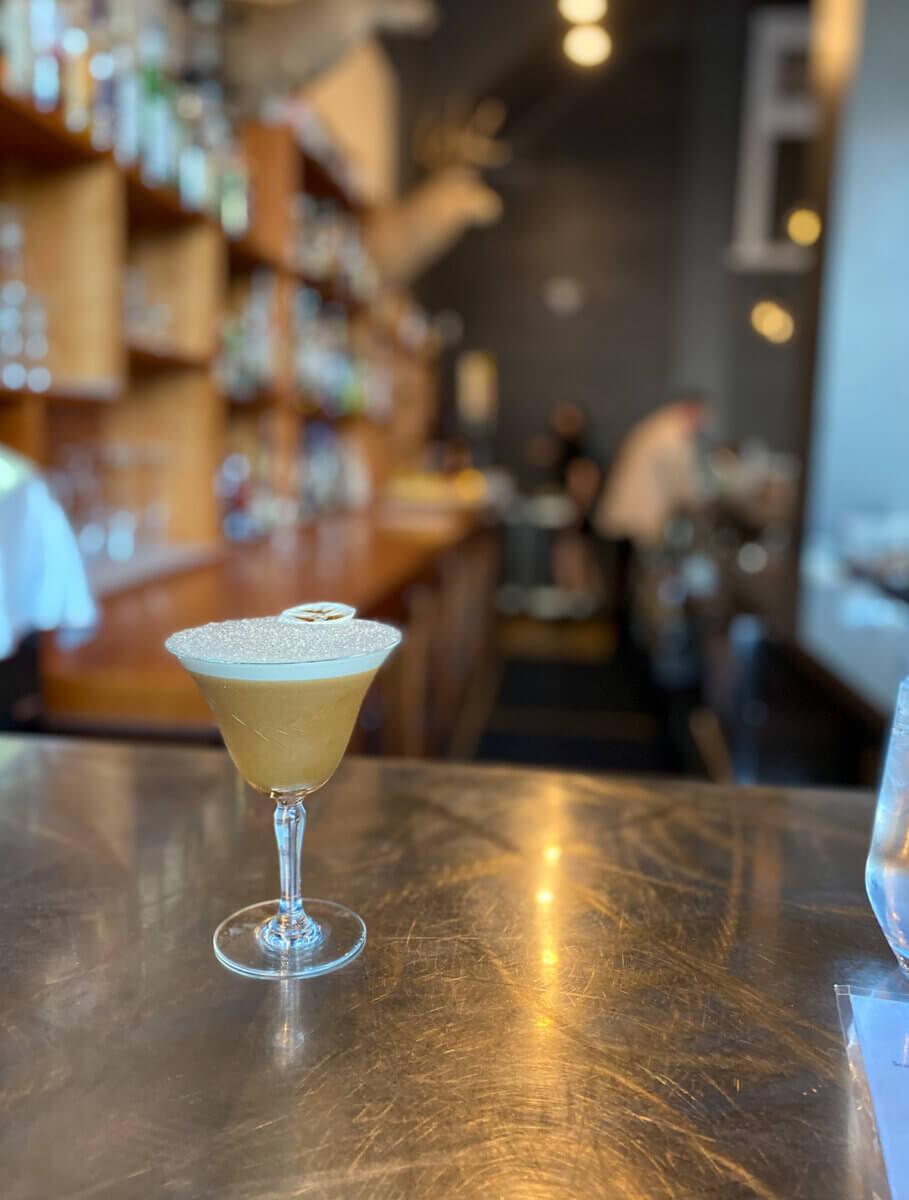 A cocktail at the bar at Ayden Kitchen and Bar, May activities in Saskatoon