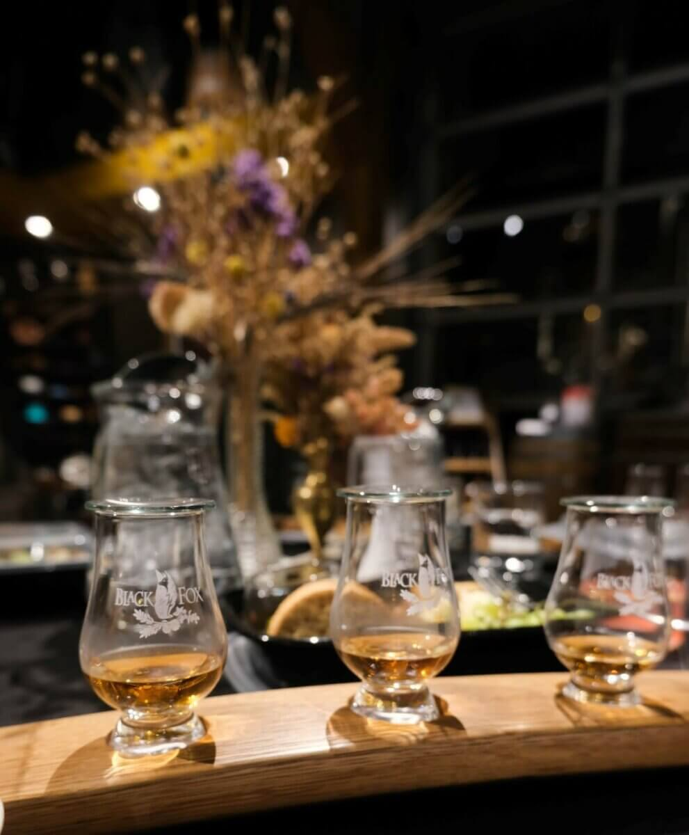 3 glasses in a whisky flight on a cocktail bar