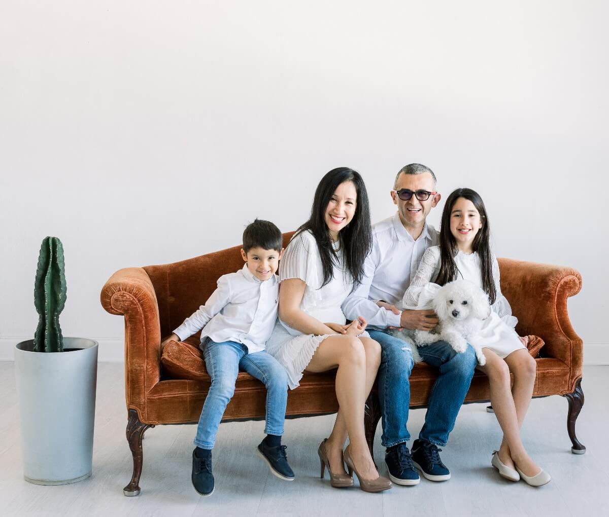 the Calderon family on a couch, started shining brownies