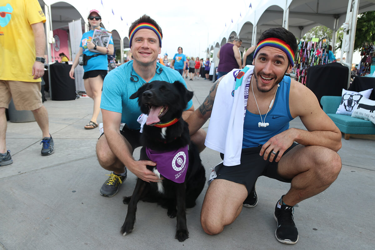 2 men runners with their black dog in strutt your mutt dallas