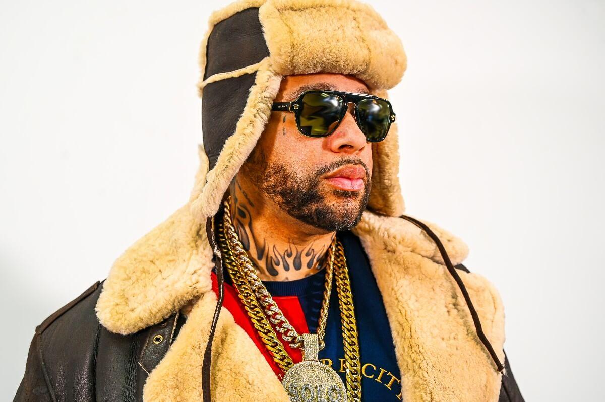 tony solo hearst in winter jacket, coat and sunglasses
