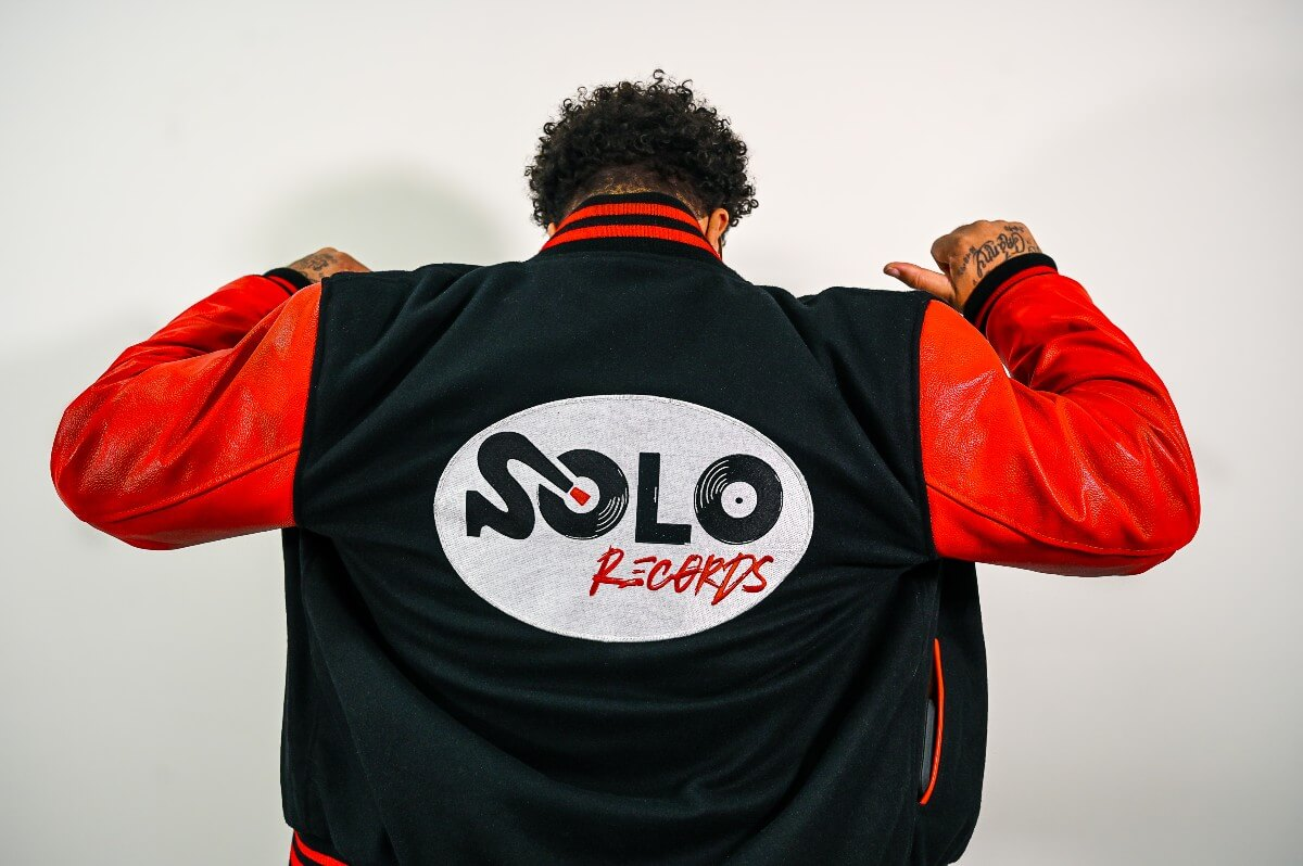 tony solo hearst showing back of his jacket with Solo Records logo