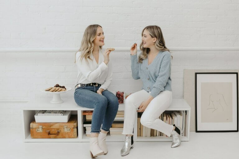two women on couch showing ally chic mom cannabis