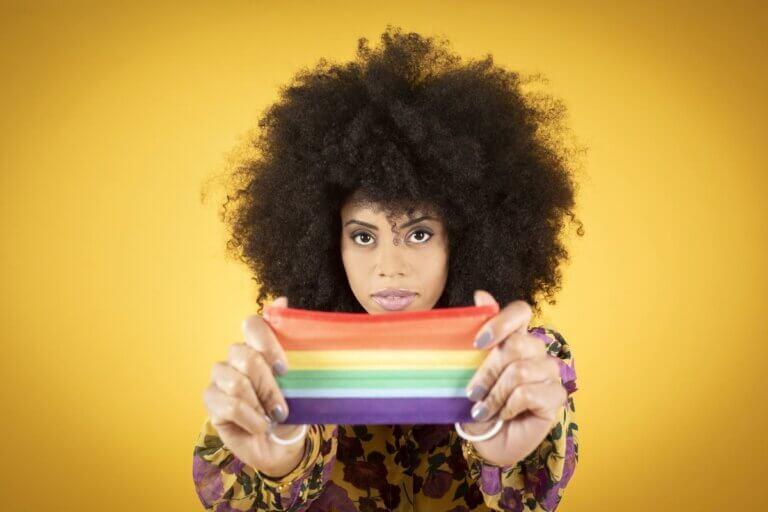 black woman holding pride flag for austin black pride