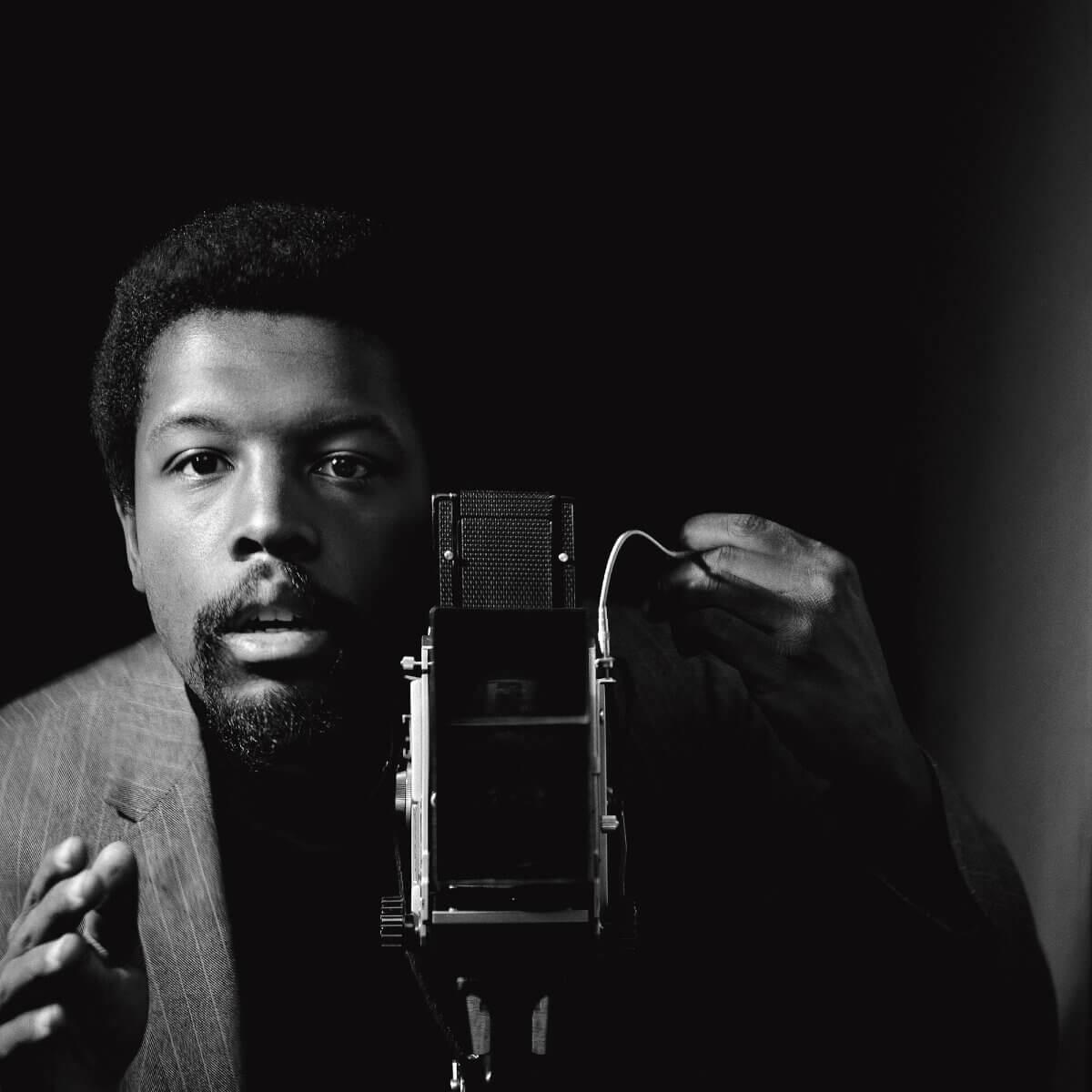 image of black man filming in Blanton Museum of Art