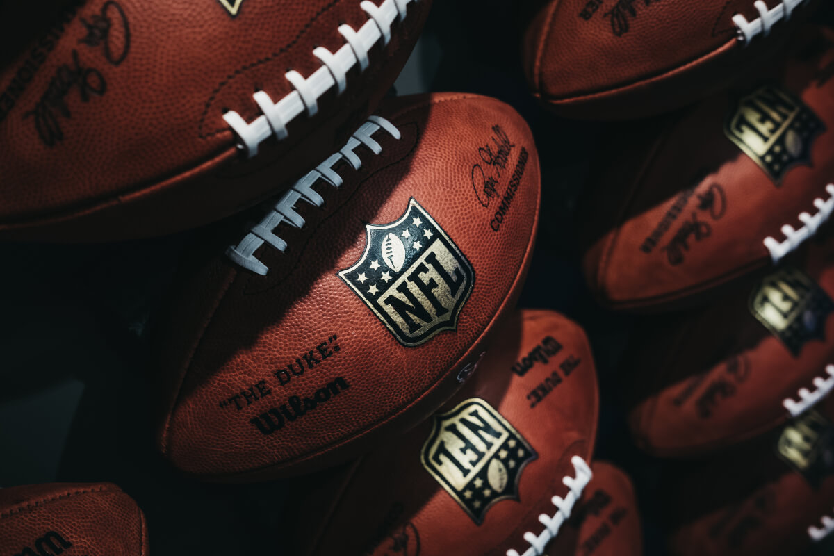 a pile of footballs for carl nassib who came out gay