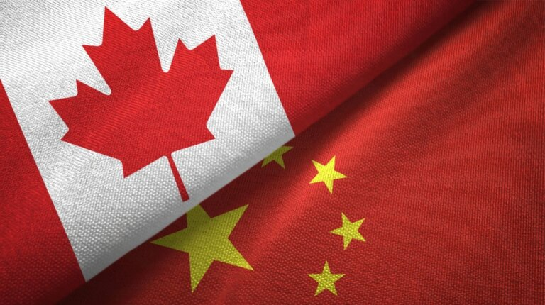canadian & chinese flags draped together for chinese canadian leaders summit