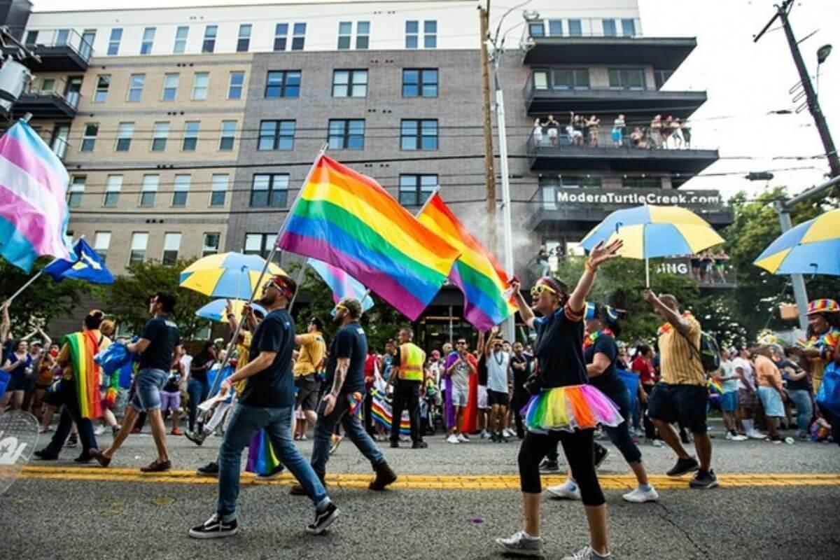 people marching in dallas pride parade