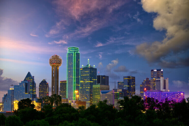 mayor eric johnson is proud of the multi-couloured night skyline of dallas