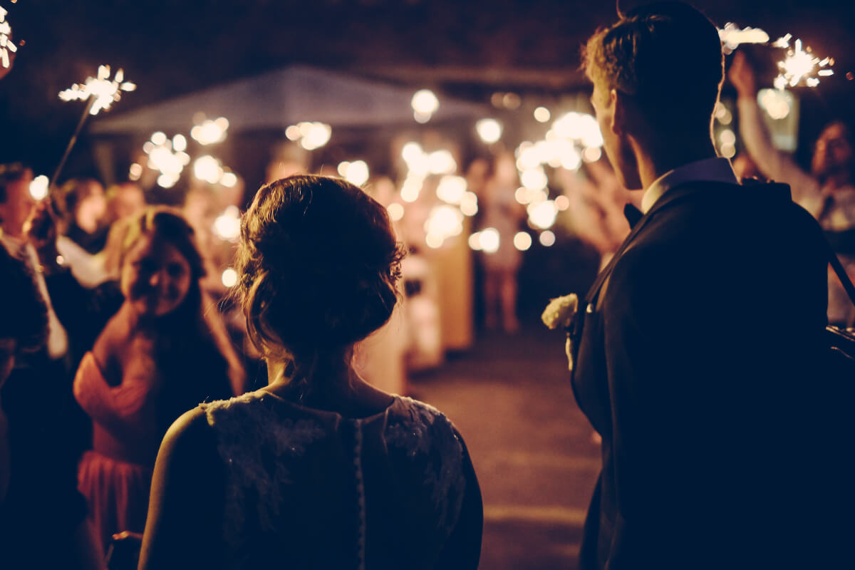 bride and groom an outdoor nighttime micro wedding
