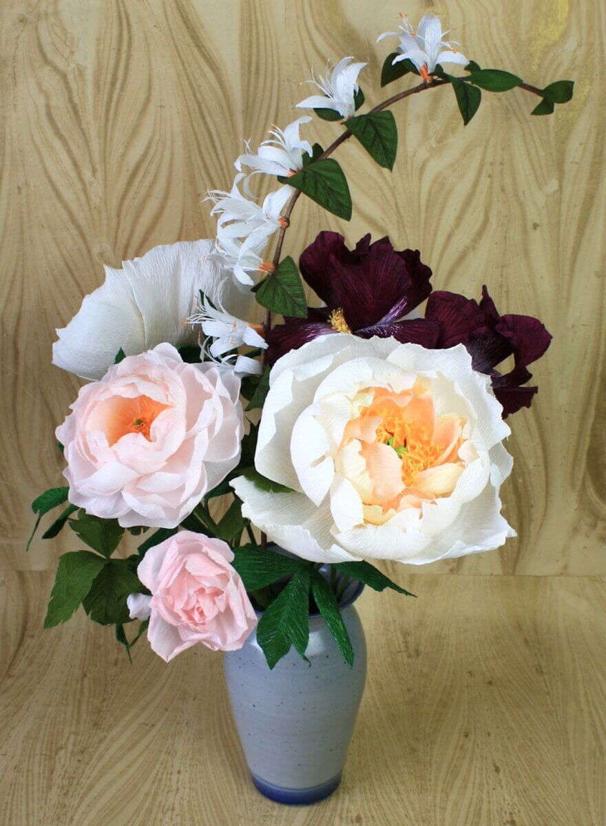 white, pink and burgundy flowers in a grey vase