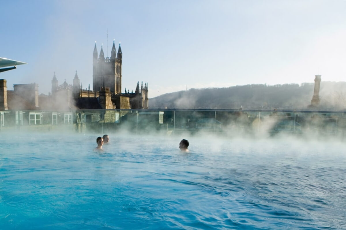 people soaking in thermal baths at Bath, England