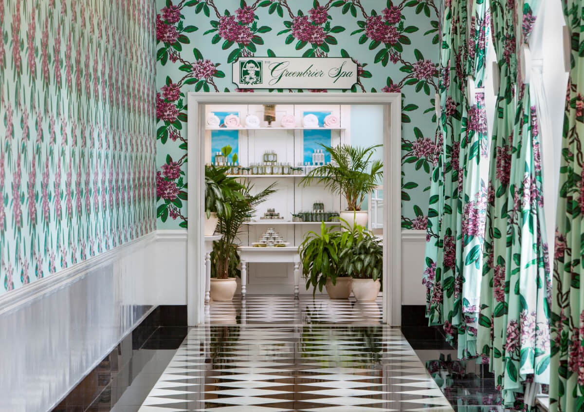 Travel for wellness at Greenbrier spa, with its entry full of mint and pink flowers