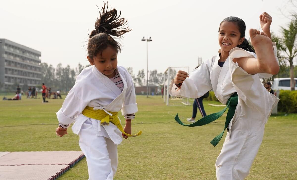 2 girls in Women's Self-Defense BJJ Class