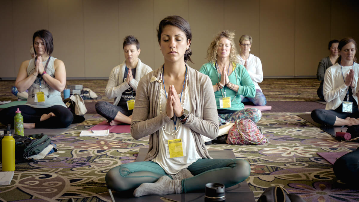 women seated in  meditation practice
