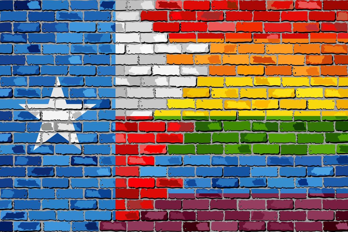 austin pride colours on texas flag painted on brick
