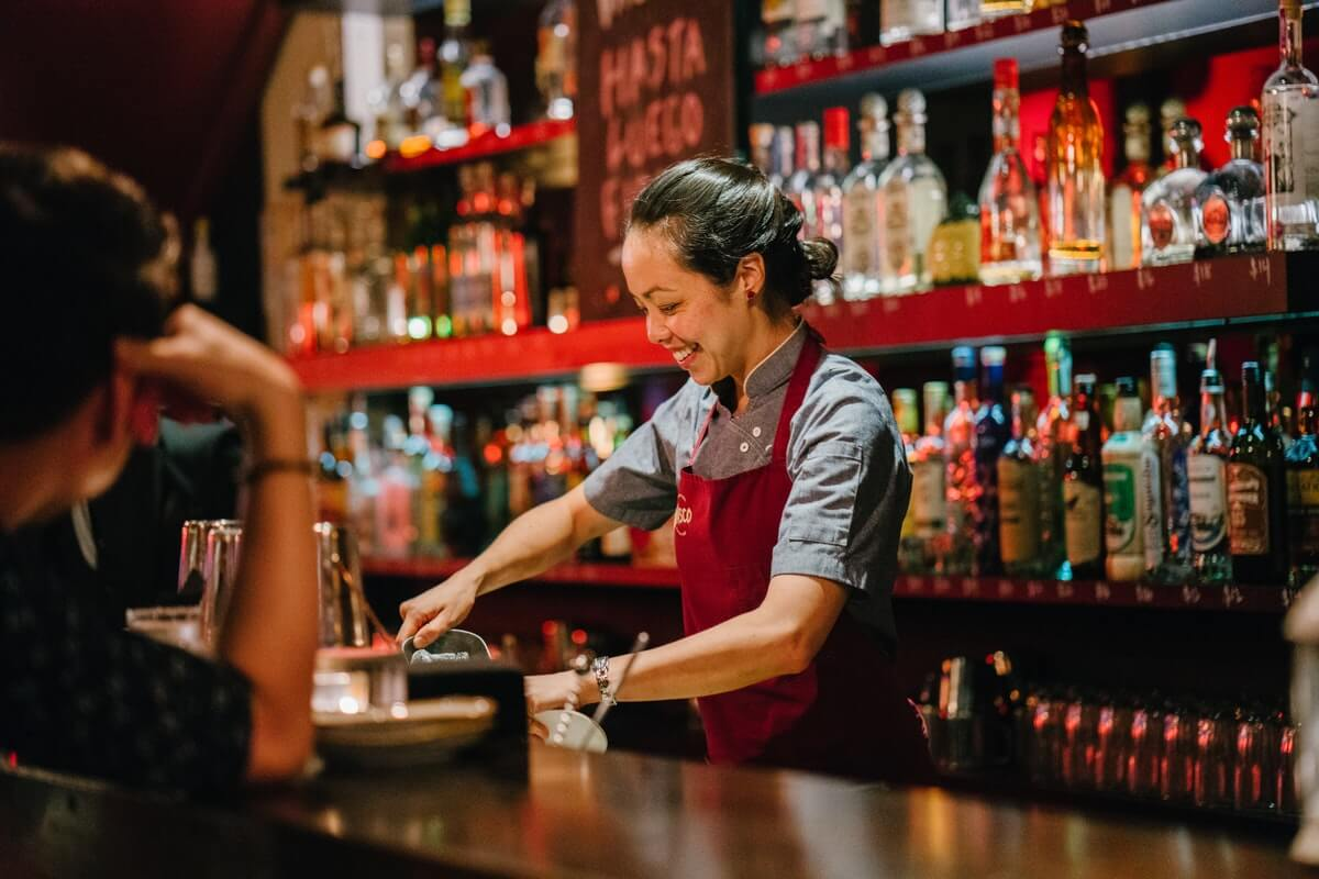 woman bartending for bartenders benevolent fund