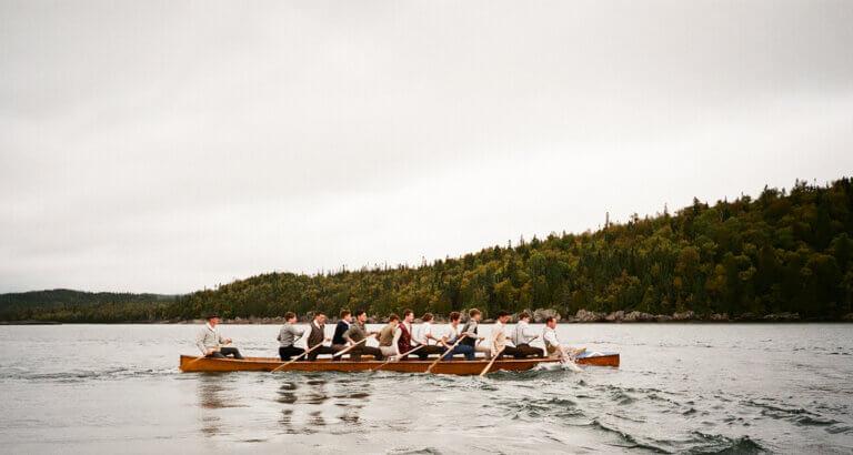 men in a canoe in brotherhood movie