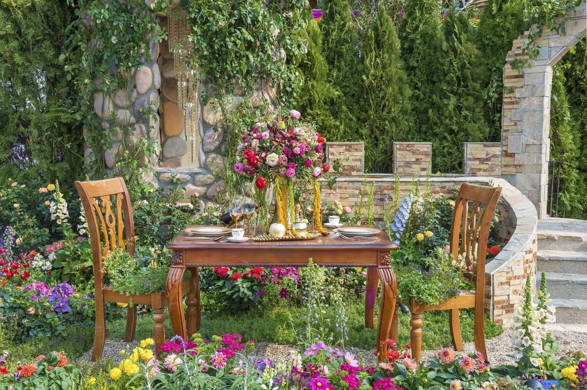 table and chairs in a stunning yard on the buffalo garden walk