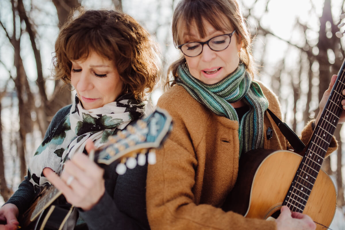 cameron & crawford outside in fall with guitars