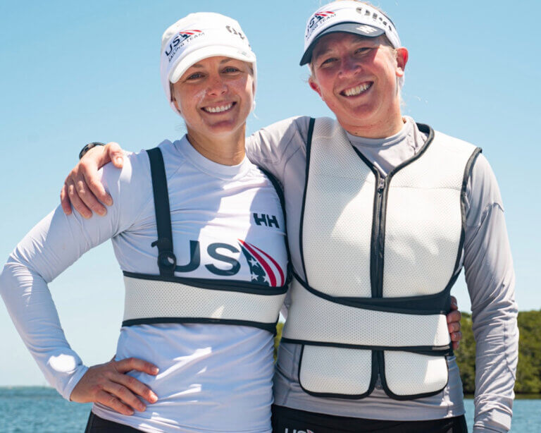 2 american olympian sailers in cooling vests