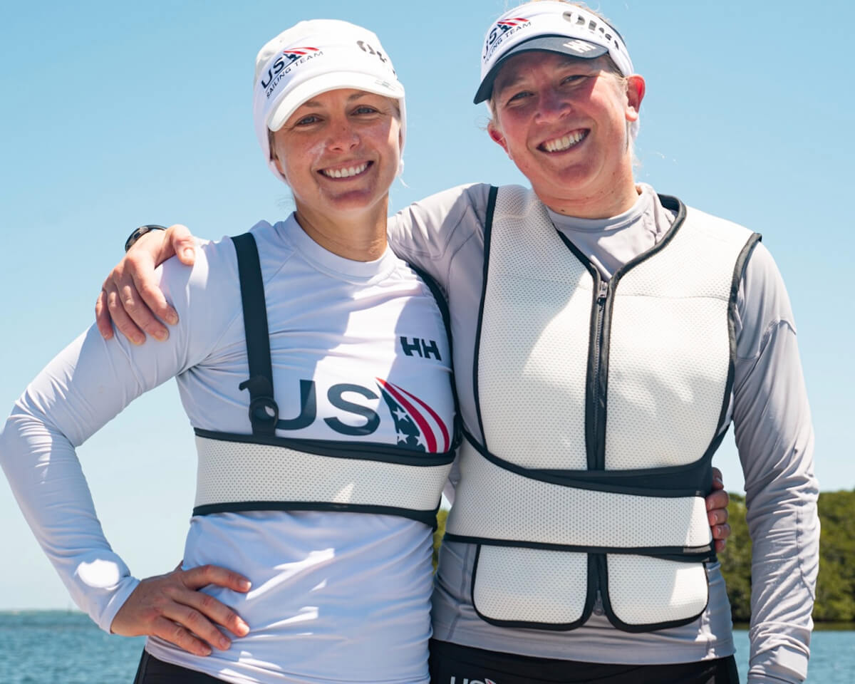 2 USA Olympic sailors wearing cooling vests