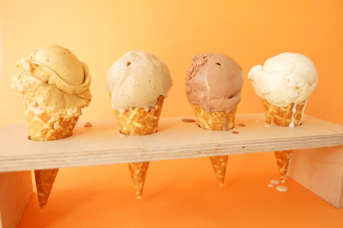 4 ice cream cones on an orange background