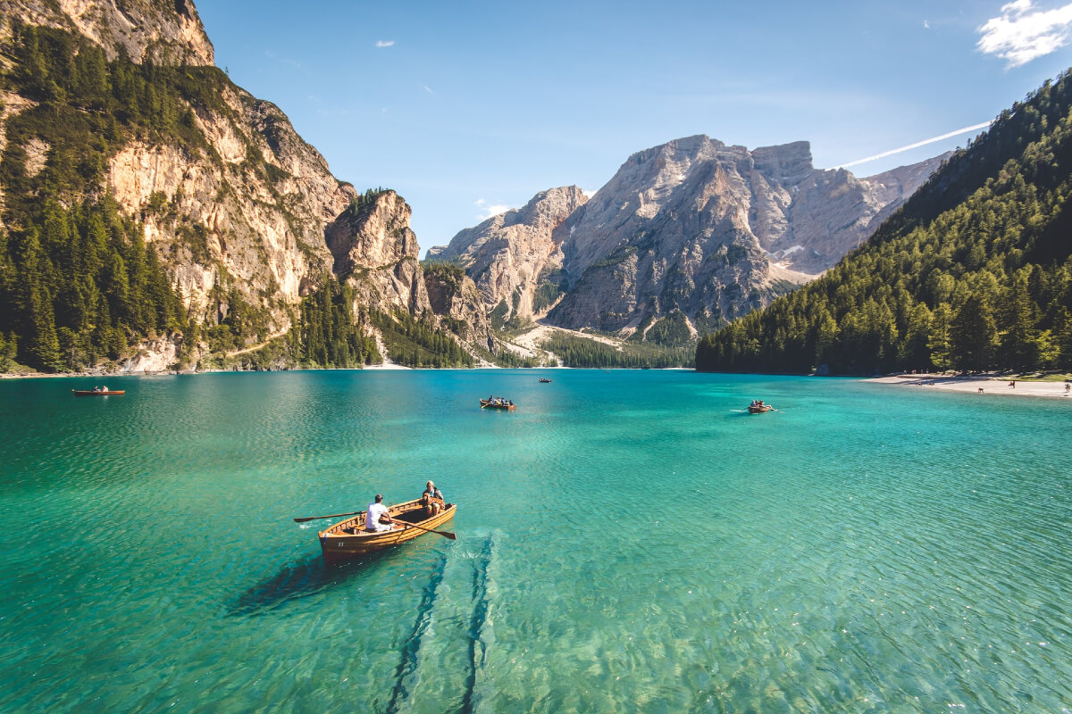 canoes on a mountain lake are green travel