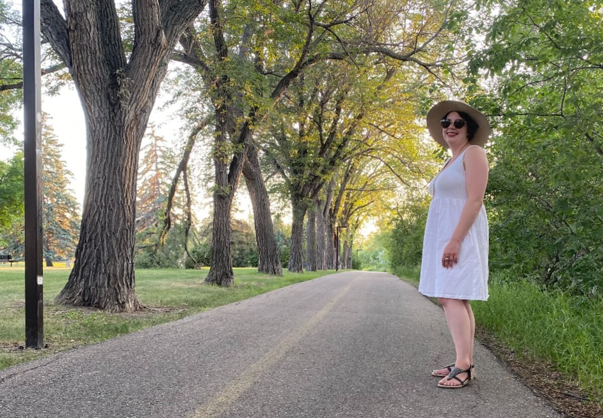 woman standing on one of the many Regina walking paths