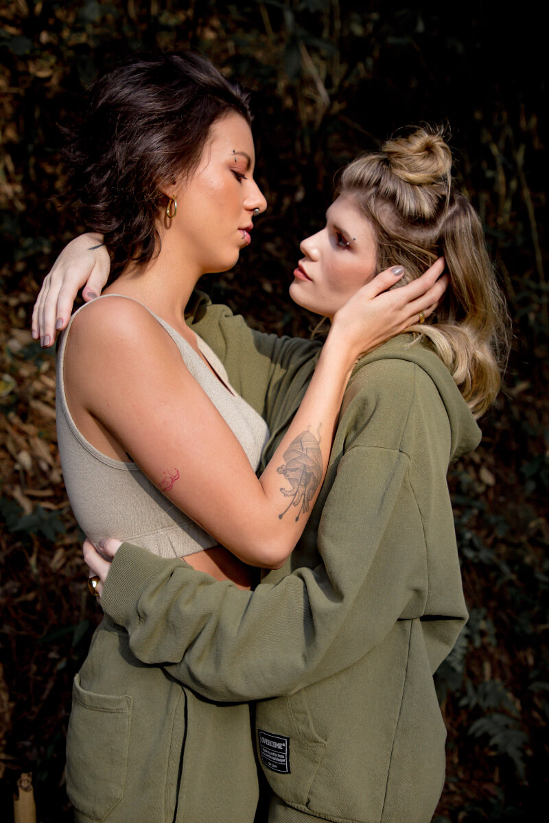 2 women in a romantic caring embrace that equates to social justice