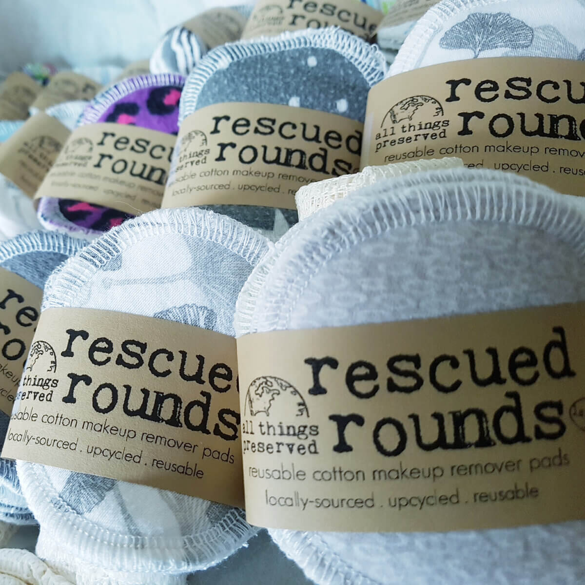 closeup of white cotton rescued rounds for removing makeup, a sustainable product by All Things Preserved