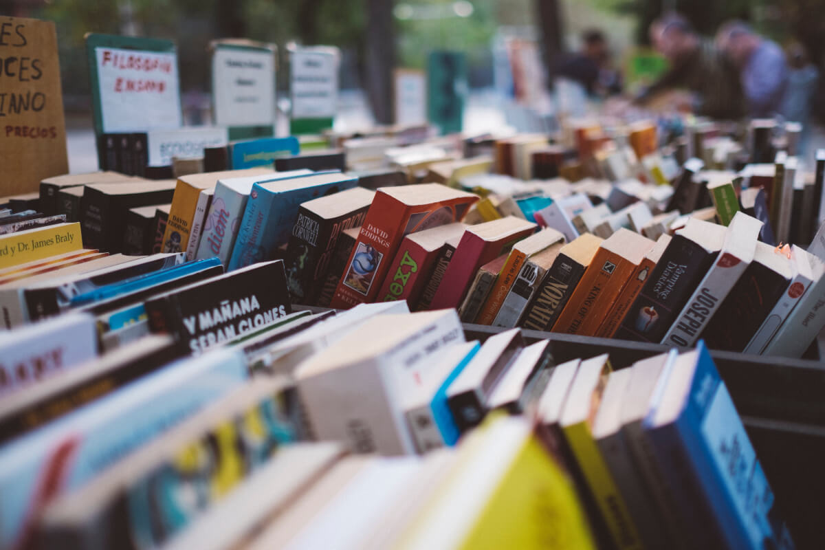 rows of books stacked for the texas book festival
