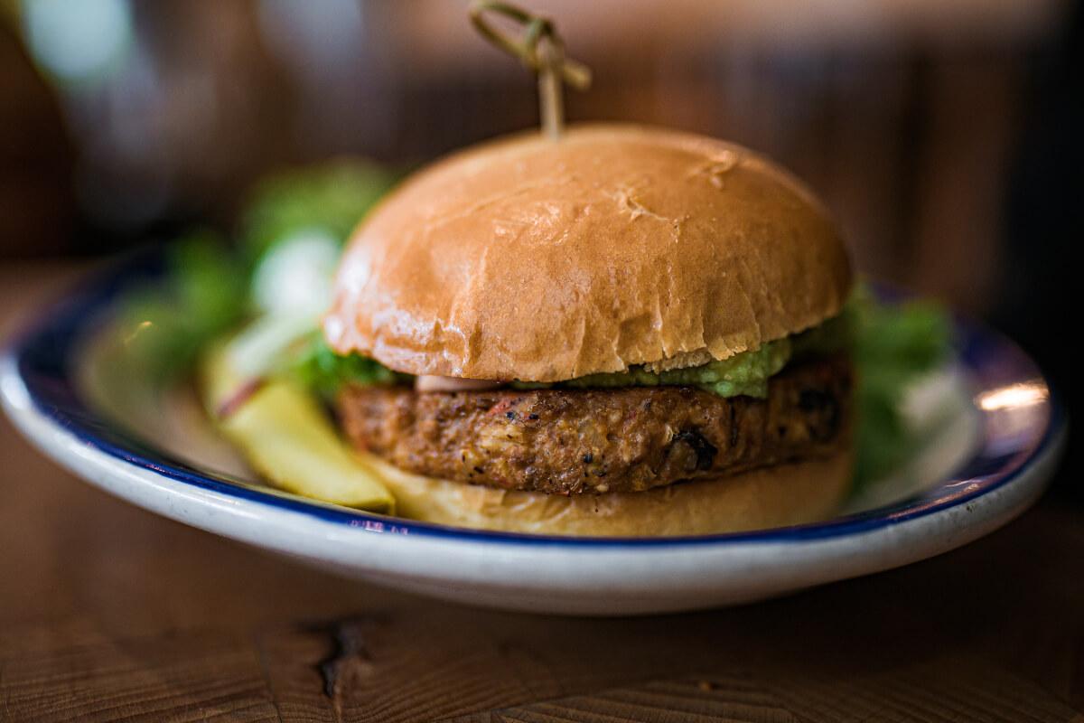 vegan burger on a plate at a buffalo vegan restaurant