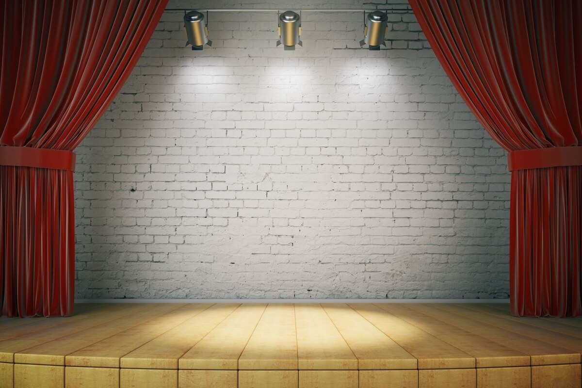 open theatre stage with lights for curtain razors production