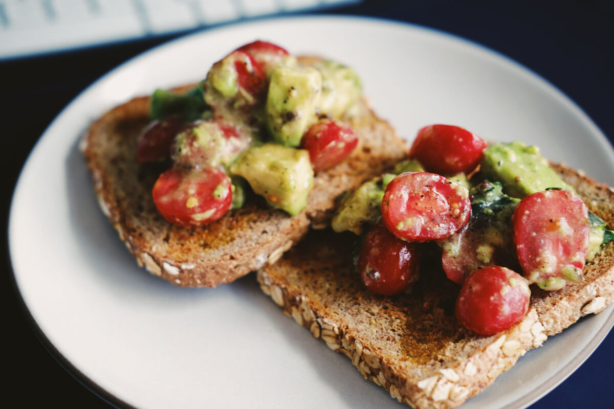 tomatoes and cucumbers on toast served at dallas vergan restaurants