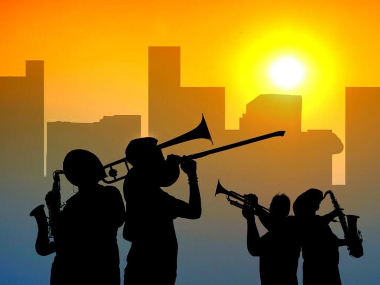 4 jazz players against a sunset at forge buffalo gathering
