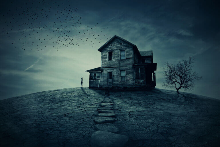 haunted house on a hill at night, a house of torment