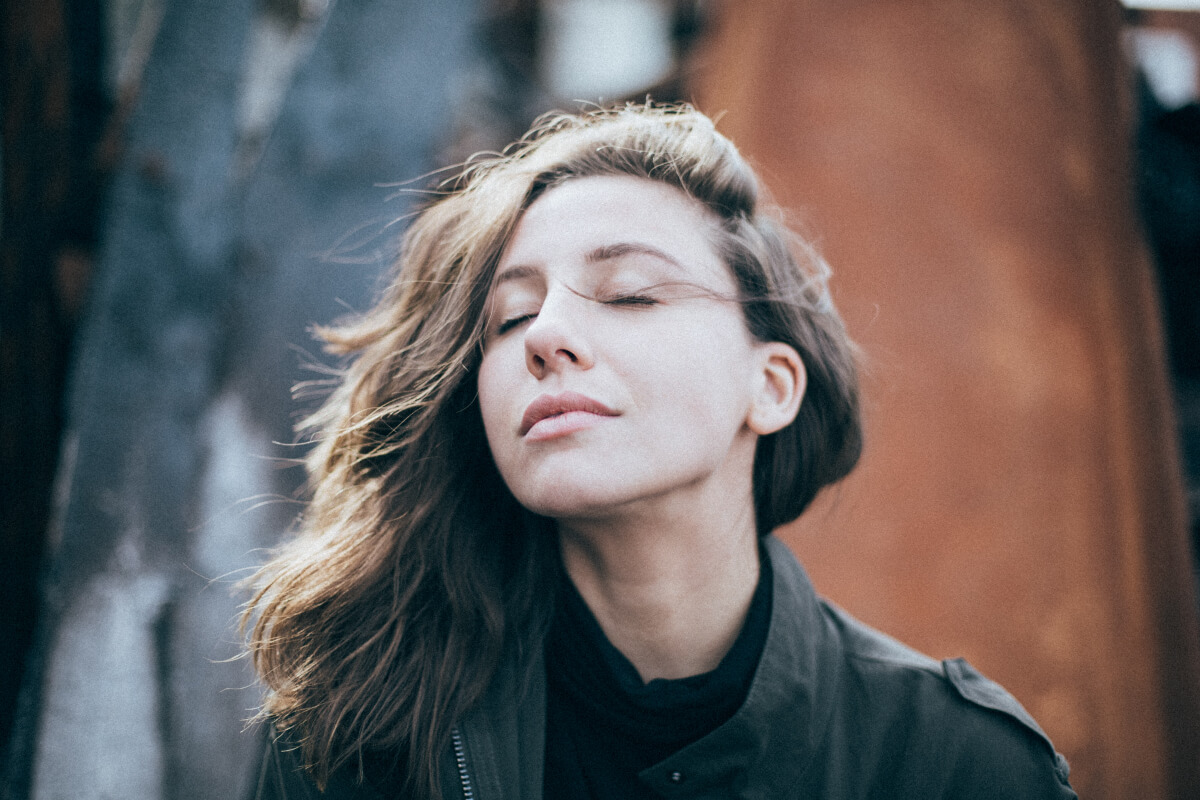 woman with eyes closed and looking calm and relaxed