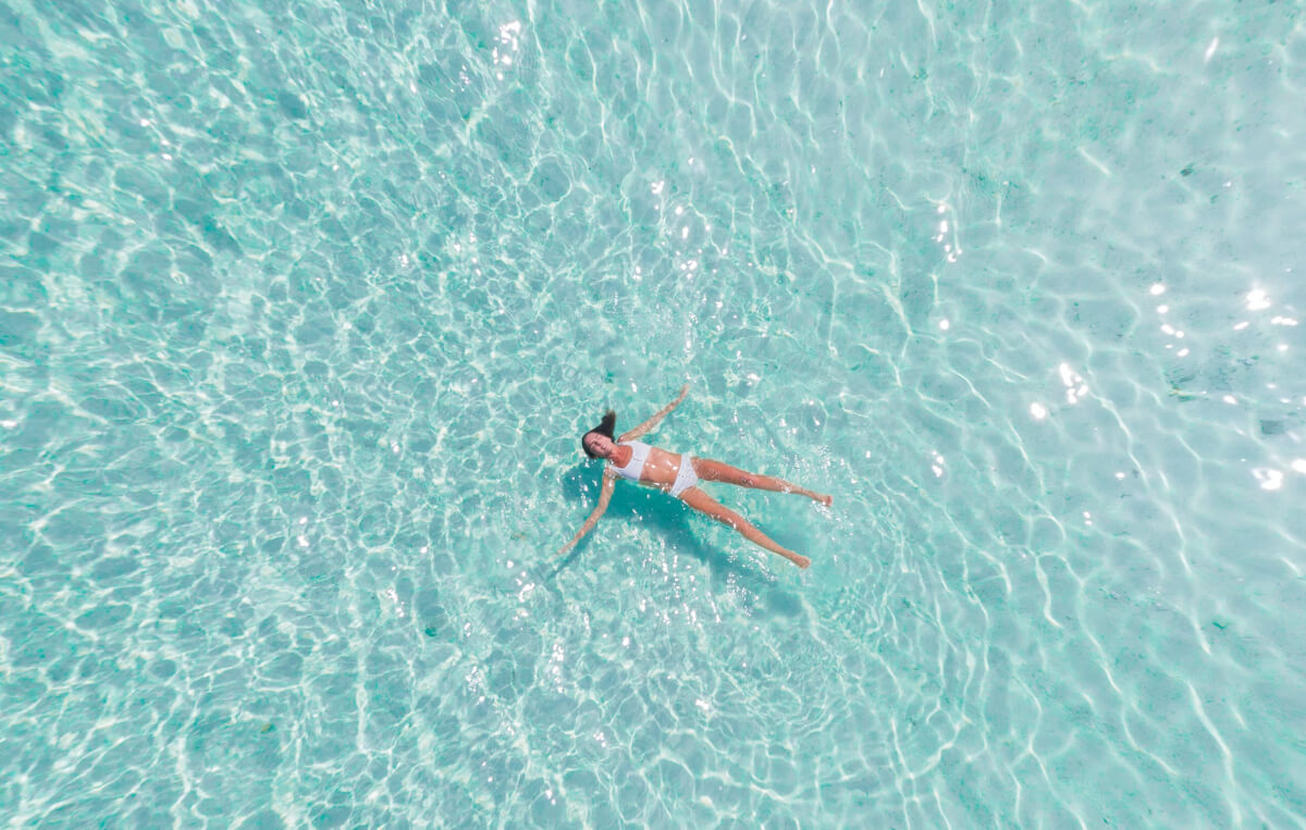 woman floating on her back in the ocean, one of many natural anxiety remedies
