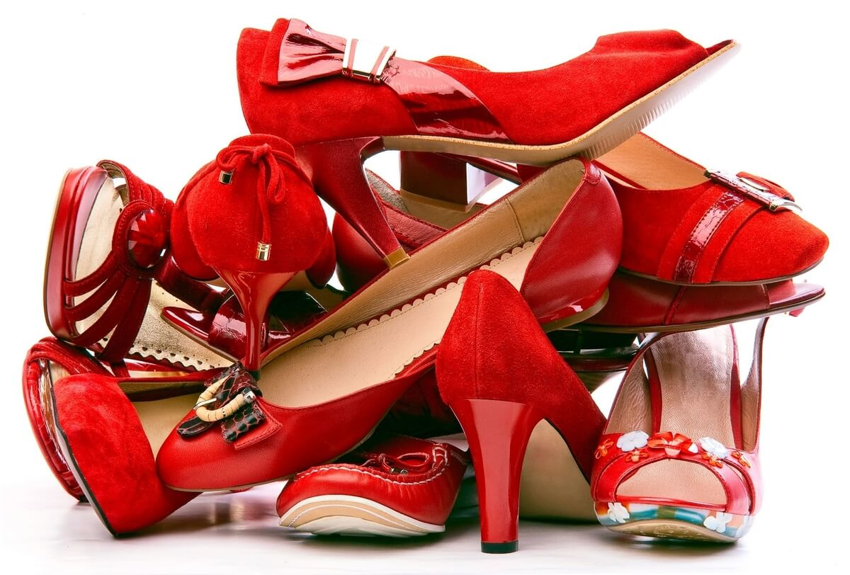 stack of red womens shoes for walk a mile in her shoes