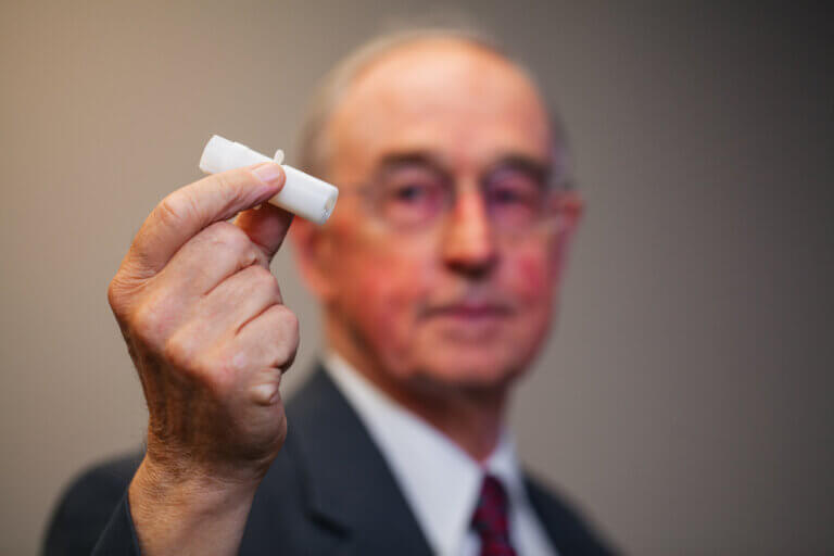 Man holds the pain-free micro-needle that will help those with a fear of needles.