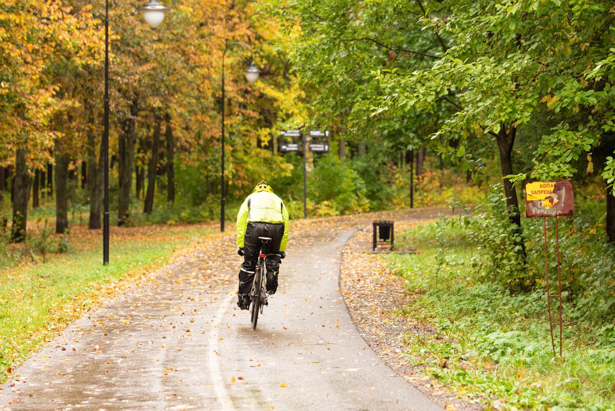 Cyclist riding through the park