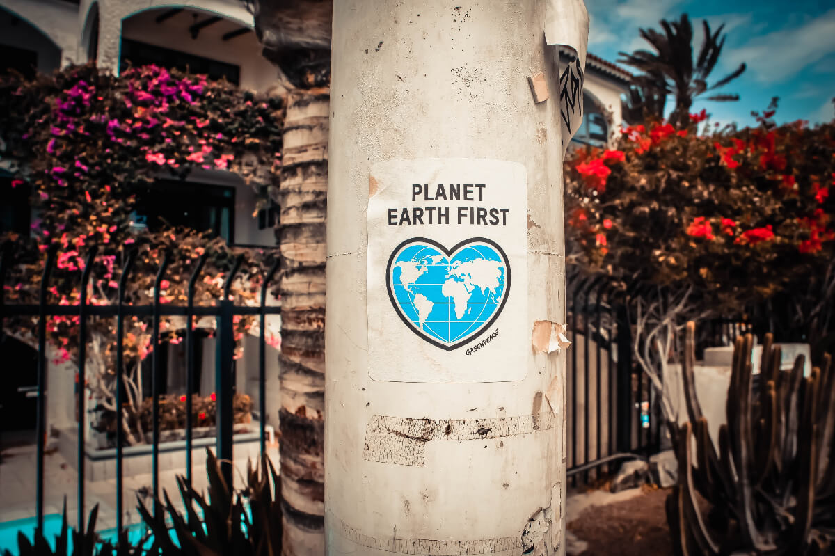 planet earth first poster on pillar promoting eco-friendly companies