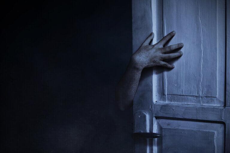 Door opening into the darkness