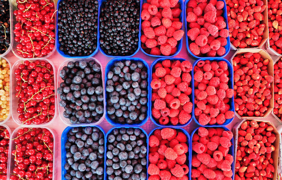 baskets of different berries that are part of healthy eating tips