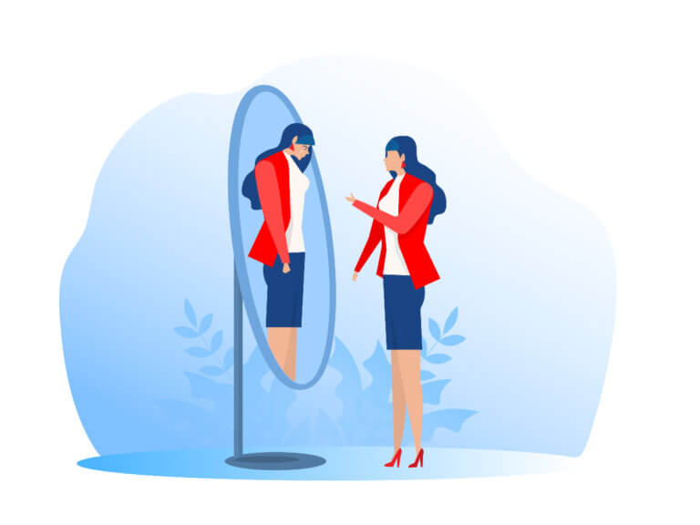 Woman looking in the mirror giving herself a pep talk