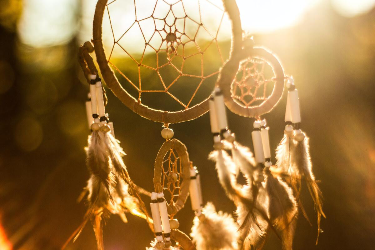 sun shining through an indigenous dream catcher