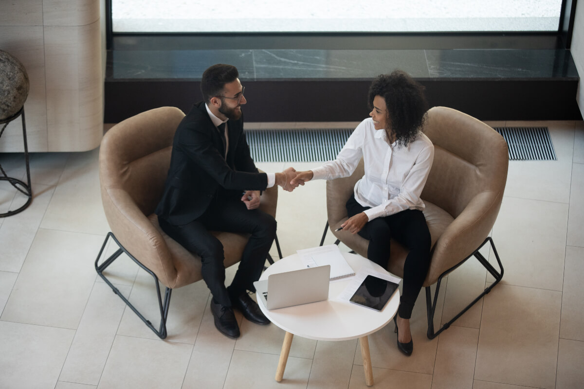 two people sitting down to negotiate