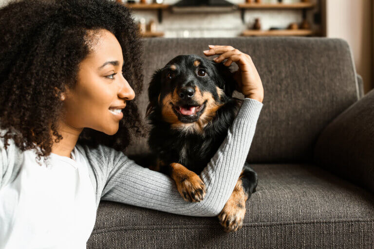 Woman petting her happy dog